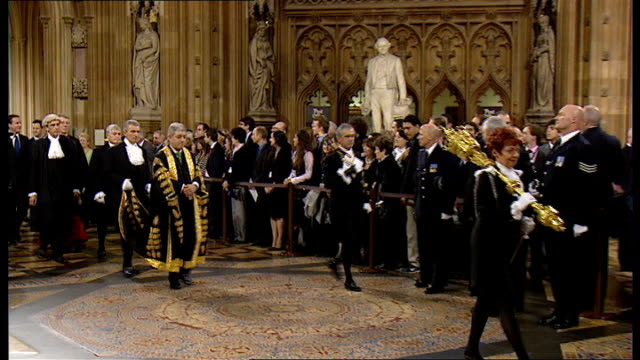 politicians and parliament officials including jill pay carrying the ceremonial mace and cameron and brown walking to house of commons alongside one... - feierliche veranstaltung stock-videos und b-roll-filmmaterial