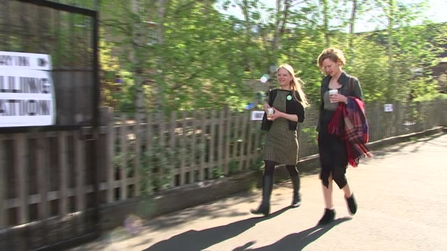 politicians arriving and leaving polling stations; camden: sian berry along / general views polling station / berry departs polling station / berry... - jachthafen stock-videos und b-roll-filmmaterial