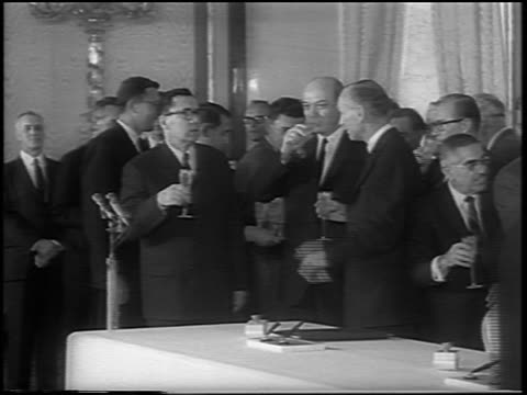 b/w 1963 politicians drinking champagne after the signing of the atomic test ban treaty / newsreel - treaty stock videos and b-roll footage