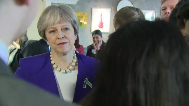 Politicians mark 100 years since some women granted the right to vote Manchester Side view Theresa May making speech May chatting with students Back...
