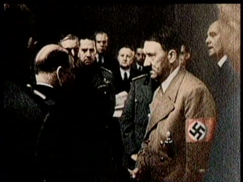 politicians sign paperwork to hand czechoslovakia over to the nazis / adolph hitler shakes hands with several politicians / czech president, edvard... - adolf hitler stock-videos und b-roll-filmmaterial