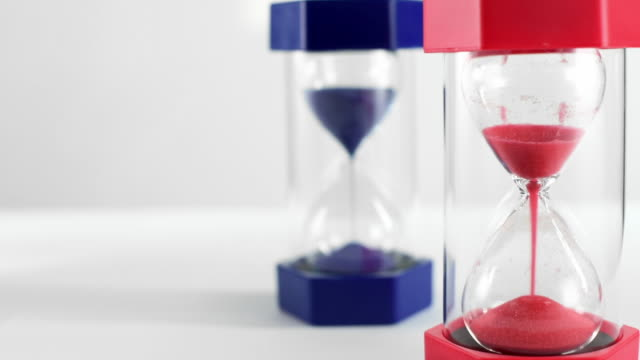 Politics Concept - Red and Blue Hourglasses Filling Up With Sand