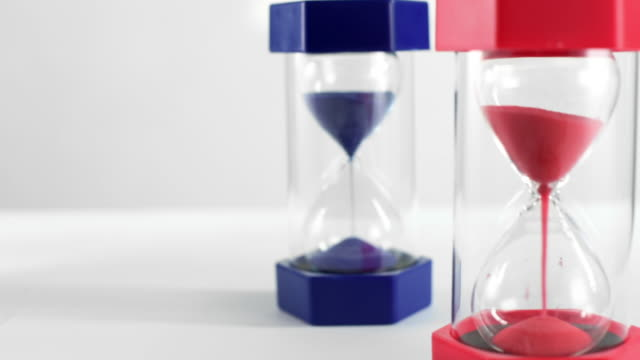 politics concept - red and blue hourglasses filling up with sand - brexit stock videos & royalty-free footage