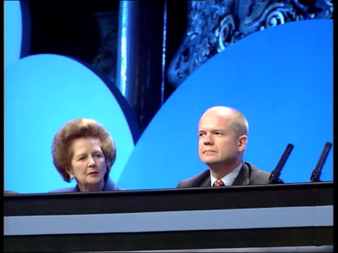 stockvideo's en b-roll-footage met conservative party conference day 3 delegates sat in conference hall lady thatcher and hague along on platform to applause delegates standing and... - conservatieve partij