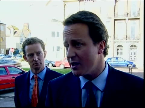 conservative party leadership election davis and cameron differ on taxes ext david cameron mp among group of supporters david cameron mp interviewed... - デビッド・キャメロン点の映像素材/bロール