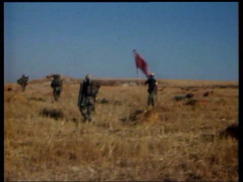 European Union Membership Offer LIB Turkish paratrooper landing in Cyprus during invasion GV Turkish paratroop soldiers along through field ZOOM IN...
