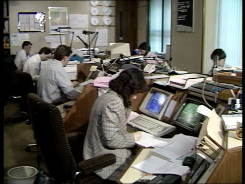 Expulsions Row INT Moscow TGV Dealing room as employees seated R Narodny TCMS Sign advising on method of payment to ITN Bank Armenia Disaster Fund