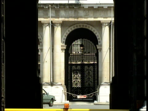 expulsions row; london parliament square sir geoffrey howe mp along to limocms howe into limoforeign office gates leading thru archway into... - gerald kaufman stock videos & royalty-free footage