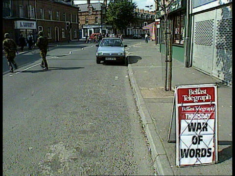 politics: first day of ira ceasefire/prisoner transfer; northern ireland, belfast bv soldiers along street past parked cars lms soldier along street... - report stock videos & royalty-free footage