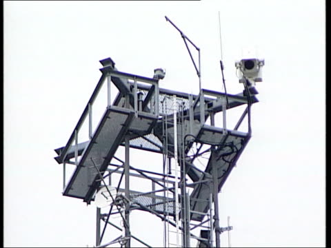 politics: gerry adams bugging claim; itn northern ireland: belfast: ext gv cctv camera metal scaffold structure with aerials attached to it tilt up... - security equipment stock videos & royalty-free footage