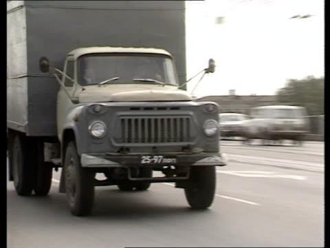 gorbachev/ resistance to reforms lorries along road = tx 25286 factory as men working = tx 25286 - 改革点の映像素材/bロール