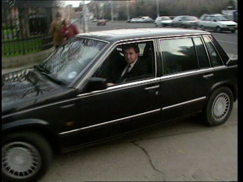 haughey resignation; cf tape no longer available ireland, dublin limousine towards and past r-l as charles haughey seated on front seat night... - spokesman stock videos & royalty-free footage