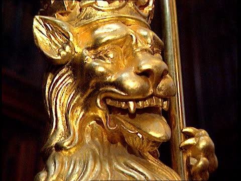 House of Lords Reform Conservative Plans ITN ENGLAND London House of Lords Royal Standard TILT DOWN gold lion below LMS Various heraldic coats of...