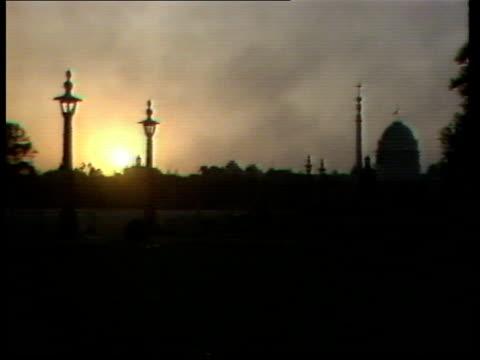 indira gandhi's assassination india new delhi gv skyline ms flag at halfmast on temple dome - assassination stock videos & royalty-free footage