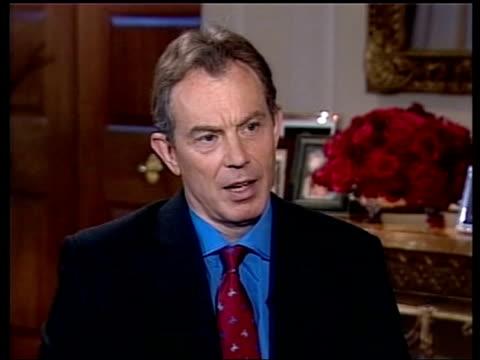 Iraq summit in Washington ITN USA Washington i/c INT Tony Blair MP shakes hands with Robinson and both sit Blair has mic attached Robinson Tony Blair...