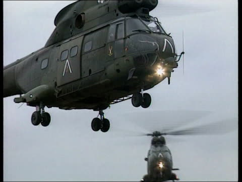 kosovo blair visit uk yugoslavia serbia kosovo pristina helicopters landing british prime minister tony blair mp from helicopter and greeted by kfor... - serbia stock videos & royalty-free footage