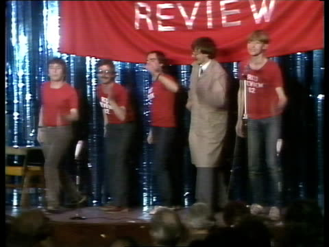 stockvideo's en b-roll-footage met labour conference militant rally england blackpool ms literature handed out ms delegates towards past more men with literature cs ceiling light tilt... - labor partij
