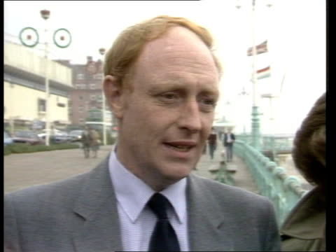 labour leadership bid england brighton promenade ms neil kinnock and wife glynis walking along sea front interview sof not only in my win on them... - brighton brighton and hove stock-videos und b-roll-filmmaterial