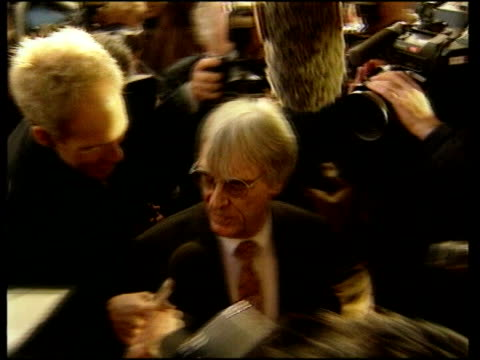 labour party donations row; lib slough: ext motor-racing boss bernie ecclestone along as surrounded by press, reduces to - bernie ecclestone stock videos & royalty-free footage