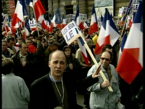 May Day Pro and Anti Le Pen Protests ITN FRANCE Paris Police officers on almost deserted street National Front supporters preparing for rally in...