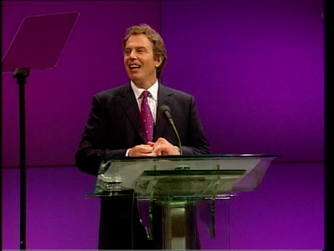 mo mowlam dies aged 55 tx prime minister tony blair mp at podium at labour party conference as audience stands and applauds after he paid tribute to... - gerry adams stock videos and b-roll footage