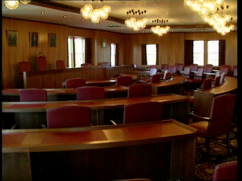 tory councillors resign; **** for rushes see cr2107 england, oxfordshire, witney gv witney street gv ditto int gv empty council chamber empty chairs... - oxfordshire stock videos & royalty-free footage