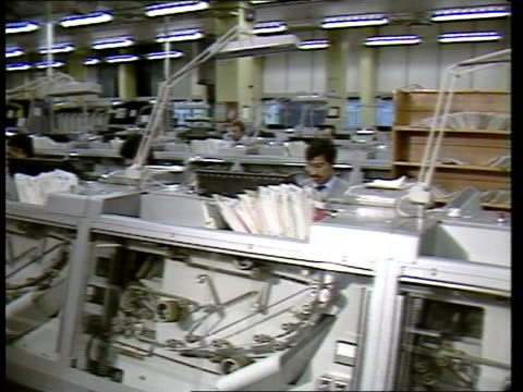 post office talks break down islington tcms two workers sorting through envelopes tx 91284 in bin itn ms men seated behind automatic sorting machines... - mail stock videos & royalty-free footage