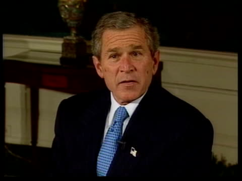 President Bush chokes on pretzel LIB Bush sitting speaking EXT LMS Bush jogging