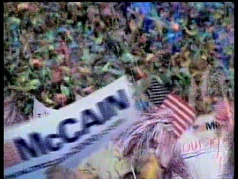 vídeos de stock, filmes e b-roll de presidential election bush defeat nn robert moore usa new hampshire gv john mccain on podium beside wife following victory in new hampshire primary... - primary election