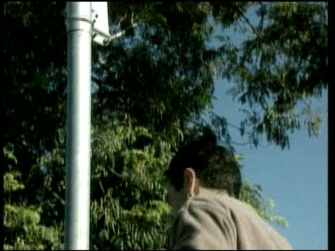 stockvideo's en b-roll-footage met republic referendum; ext man climbing up post to put up 'ramsay street' sign on post on set of australian television soap neighbours gv ditto lms... - bord weg afgesloten