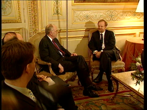 Robin Cook visit ITN Robin Cook MP sitting reading papers FRANCE Paris French foreign ministry BV Cook amp entourage up steps amp into building Cook...