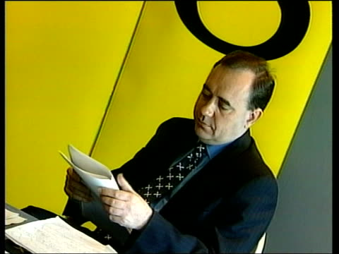 scottish parliament election campaign itn alex salmond mp sitting looking at document gv press salmond along to press conference podium and la... - alex salmond stock videos & royalty-free footage