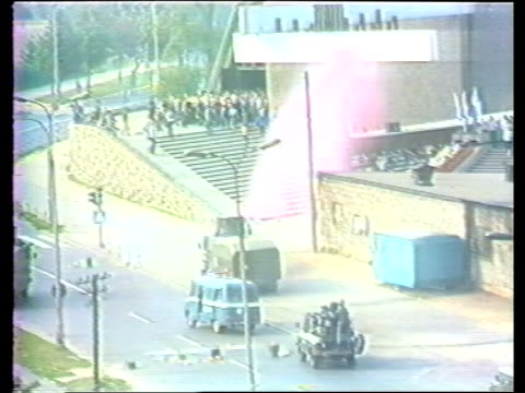 solidarity riots poland nowa huta ts water cannon sprays pink dye ts crowds outside church as cannon squirts out pink dye ts blue dye sprayed onto... - shipyard stock videos & royalty-free footage
