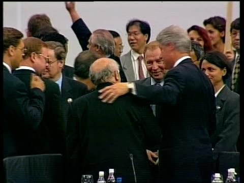 politics: stability summit; pool bosnia-herzegovina: sarajevo: int clinton talking with others - krishnan guru murthy stock videos & royalty-free footage