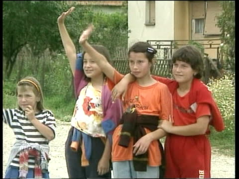 Politics Stability Summit REUTERS YUGOSLAVIA Serbia Kosovo Russian military vehicles along road Children waving to Russian soldiers Serbs watching...