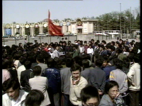 student demonstrations china beijing backwards students towards holding banner ms side student marchers lr past spectators la student under red flag... - 1989 stock videos & royalty-free footage