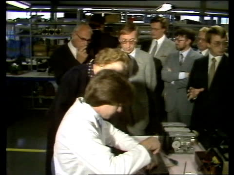 Thatcher Visit SCOTLAND Strathclyde Beith TS Denis and Margaret Thatcher Prime Minister walk LR into factory MS Man working on computer LMS Margaret...