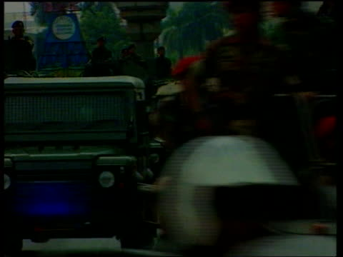 Unrest Suharto refuses to quit ITN INDONESIA Jakarta Military vehicles along road AntiSuharto demonstrators on street PULL Demonstrators around...