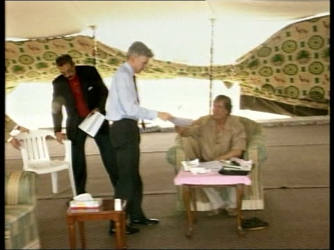 visit by british foreign office minister itn libya sirte mike o'brien along thru tent to meet colonel muammar gaddafi pan gvs o'brien sitting around... - muammar gaddafi stock videos & royalty-free footage