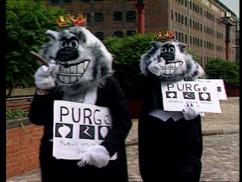 Industry Government Clapdown on Fat Cat Pay Rises LIB ENGLAND Manchester People dressed as `Fat Cats' and wearing crowns along holding cigars and...