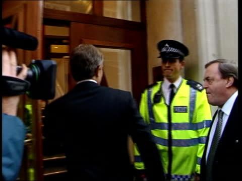 government dossier published dossier reaction itn tony blair mp towards along street into building followed by john prescott mp as arriving for... - file stock videos & royalty-free footage
