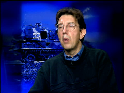 russians warn chechens to leave grozny within 5 days; itn england: int paul beaver interview sot - they are trying to carry out scorched earth... - grosny stock-videos und b-roll-filmmaterial