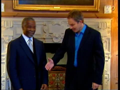 stockvideo's en b-roll-footage met tony blair meets south african president thabo mbeki pool tony blair shakes hands with thabo mbeki lib usa washington blair and george w bush along... - tony blair