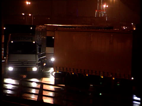 illegal immigrants lorry drivers fines lib france calais lorries along - calais stock videos and b-roll footage