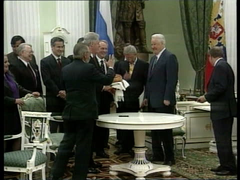 Politics/Economy Economic Crisis Clinton Visit POOL US President Bill Clinton shaking hands with President Boris Yeltsin and embracing Clinton...