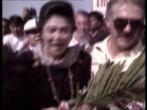 imelda marcos tms people rolling out red carpet pan lr ms waving crowds zoom in cms imelda marcos in crowds cms security guards shouting at crowds... - mother in law stock videos & royalty-free footage
