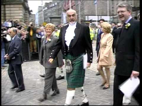 queen opens parliament; itn scotland: edinburgh: ext crown of scotland carried up steps to scottish parliament building preceded by heralds pipe band... - member of the scottish parliament stock videos & royalty-free footage