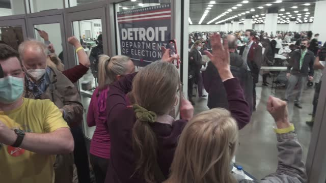 """poll challengers slam the windows of the department of elections in the tcf center yelling """"stop the count,"""" on november 4, 2020 in detroit,... - detroit michigan stock videos & royalty-free footage"""