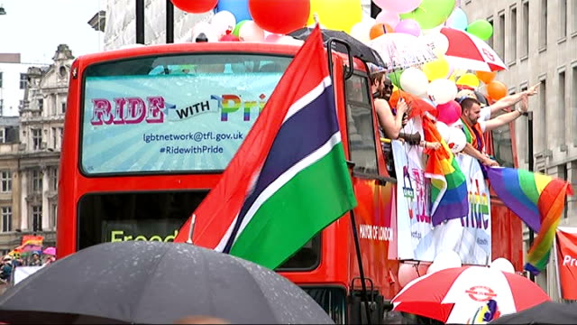 poll reveals londoners less likely to be supportive of gay children than rest of uk r28061404 / various shots gay pride march with people and floats... - festivalsflotte bildbanksvideor och videomaterial från bakom kulisserna