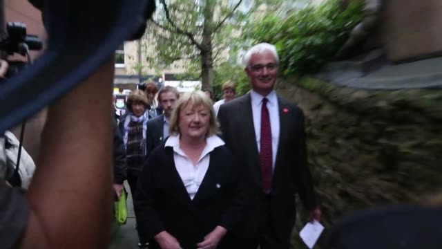 stockvideo's en b-roll-footage met a polling place sign fixed to the wall of a polling station on the day of the scottish independence referendum in edinburgh uk on thursday sept 18... - goede staat